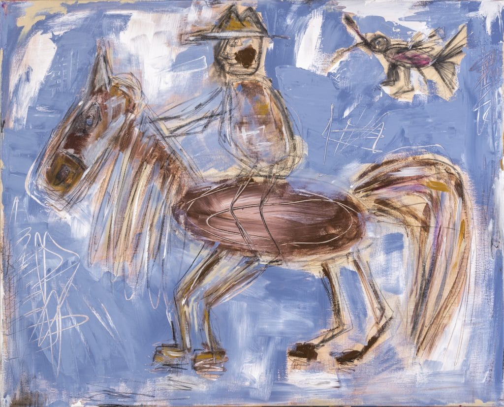 Rider in blue and brown